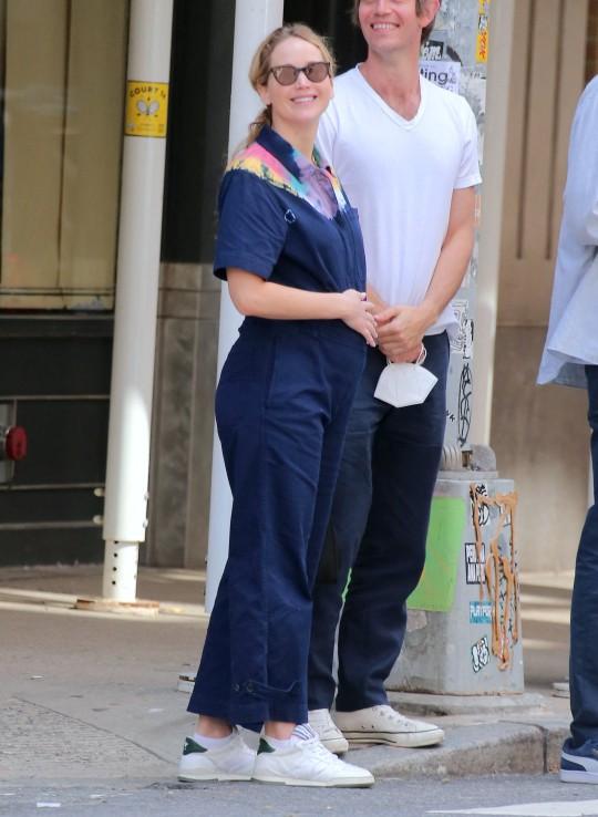 Jennifer Lawrence cradling baby bump with husband Cooke Maroney