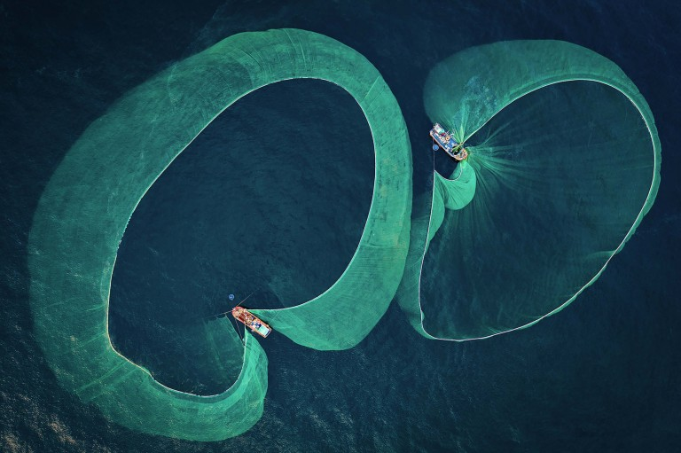These are the stunning aquatic images that have wowed the judges at the annual Ocean Photography Awards 2021. // Photographer: Thien Nguyen Ngoc / Anchovy fishing boats photographed from above along the coastline of Phu Yen province, Vietnam. / Location: Phu Yen province, Vietnam // TRIANGLE NEWS 0203 176 5581 // news@trianglenews.co.uk SHARKS smile for the camera, sleepy turtles glide through the sea and a fish puffs on a cigarette in these striking photos. The stunning snaps were honoured in the prestigious 2021 Ocean Photography Awards, which has just announced its winners. The annual awards focus on adventure, conservation and exploration of the deep blue sea.