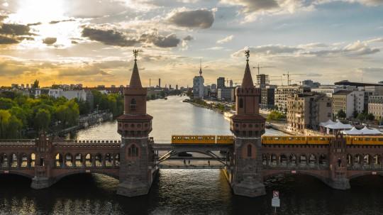 Oberbaum Bridge in Berlin before sunset. Aerial view
