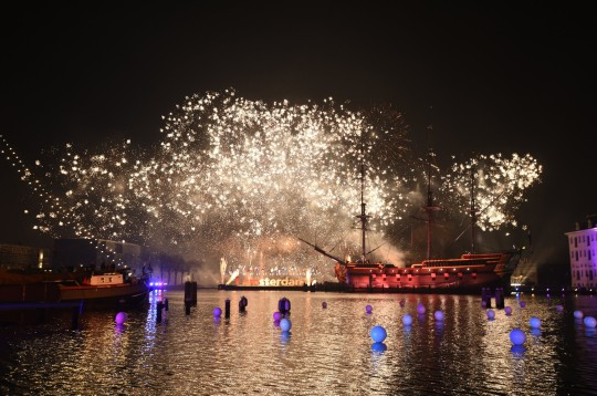 A photo taken on January 1, 2016 shows fireworks ver the Scheepsvaartmuseum (Shipping museum)during New Year's Eve in Amsterdam. / AFP / ANP / ROBIN VAN LONKHUIJSEN / Netherlands OUT (Photo credit should read ROBIN VAN LONKHUIJSEN/AFP via Getty Images)
