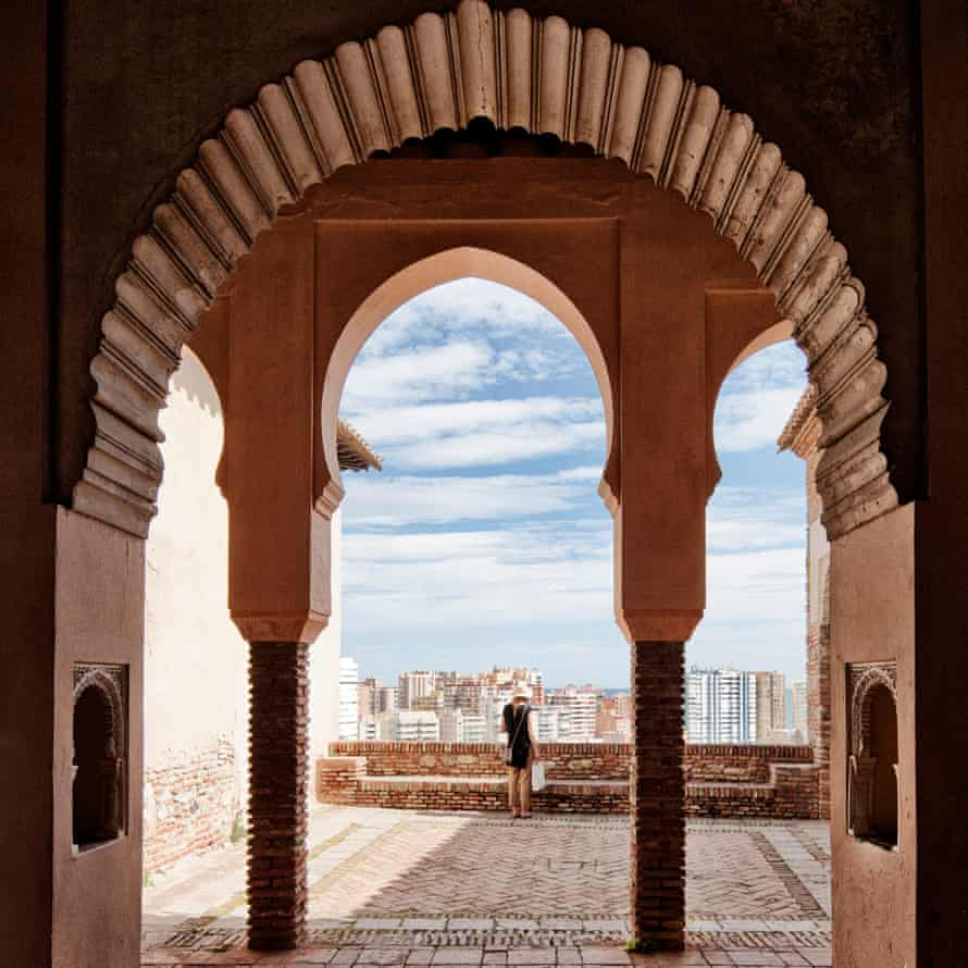 A view through an ornate window in the Alcazaba moorish fortress, Malaga, Spain.