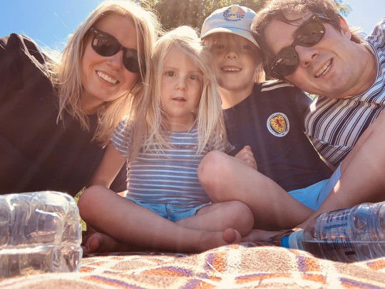 Beth Neil is pictured having a sunny picnic with her family