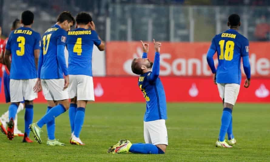 Everton Ribeiro on his knees in celebration after scoring Brazil's winner in Chile.
