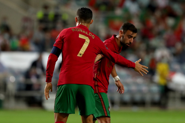 Manchester United stars Cristiano Ronaldo and Bruno Fernandes look on during Portugal's World Cup qualifier with the Republic of Ireland
