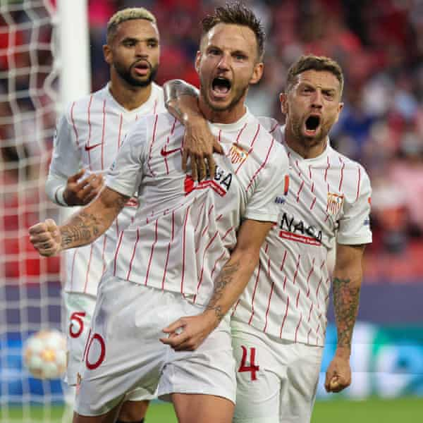 Ivan Rakitic (centre) celebrates after converting from the penalty spot for Sevilla.