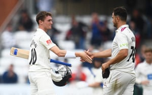 George Balderson is congratulated by Somerset's Jack Brooks.
