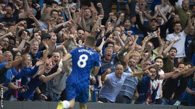 Chelsea fans celebrate inside Stamford Bridge