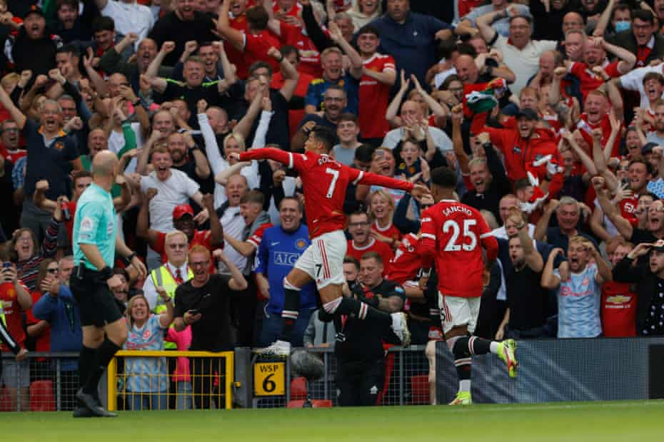 Fans celebrate after Cristiano Ronaldo scored his, and Manchester United's second goal of the game.