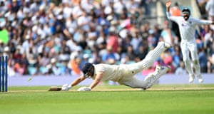 Dawid Malan fails to make the crease and is run-out.