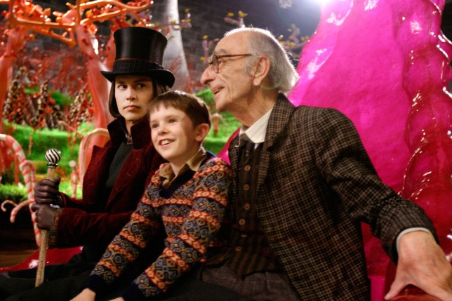 Charlie and The Chocolate Factory (2005); Johnny Depp (left) pictured as Willie Wonka, with Freddie Highmore (centre) as Charlie Bucket, with David Kelly as Grandpa Joe