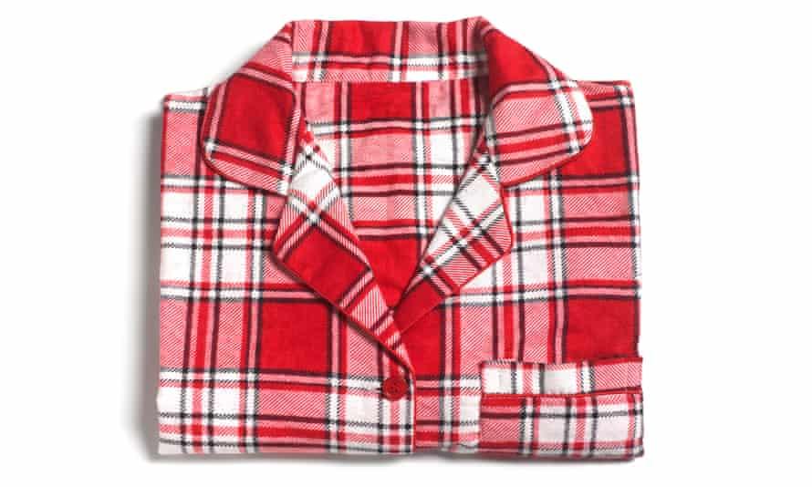 A pyjama shirt, neatly folded