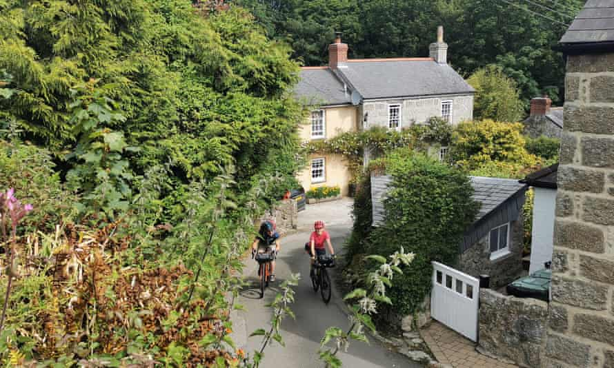 Rob Penn (freelance) and Sophie Gordon (Cycling UK) cycle along winding country lanes near Lamorna during a recce ride of Cycling UK's West Kernow Way, June 2021. The 230km route is part of the EU-funded EXPERIENCE project to develop sustainable year-round tourism activities in Cornwall.
