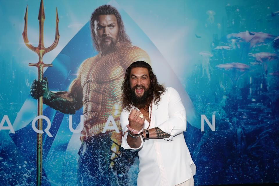 Jason Momoa (promoting the first Aquaman film in 2018) showed off his costume for the sequel. (Photo: Chris Hyde/Getty Images)