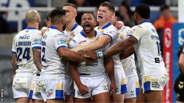 Kruise Leeming celebrates with Leeds team-mates