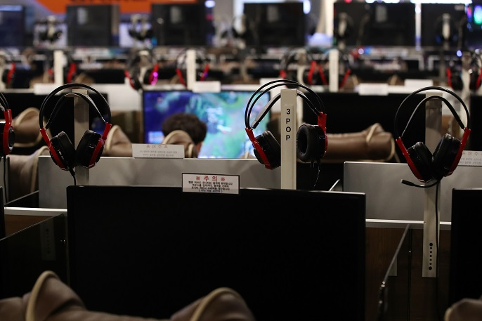 This file photo shows a person playing online games at an internet cafe in Seoul. (Yonhap)