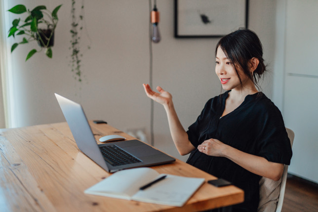 Confident Pregnant Woman Working At Home With Laptop