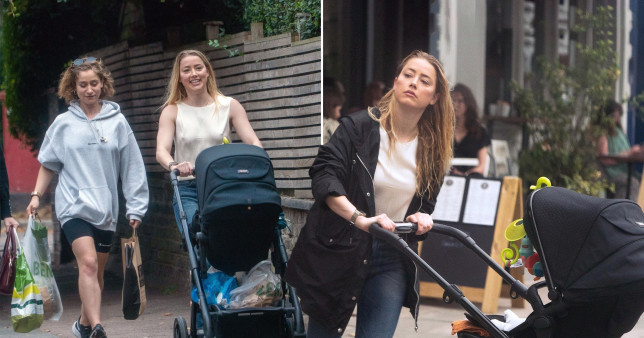 Picture of Amber Heard walking and pushing a pram