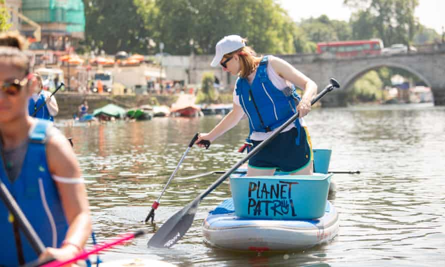 Paddleboarding clean up, River Thames On Planet Patrol's clean ups, participants paddleboard, parkour and yoga their way to plastic-free beaches and rivers