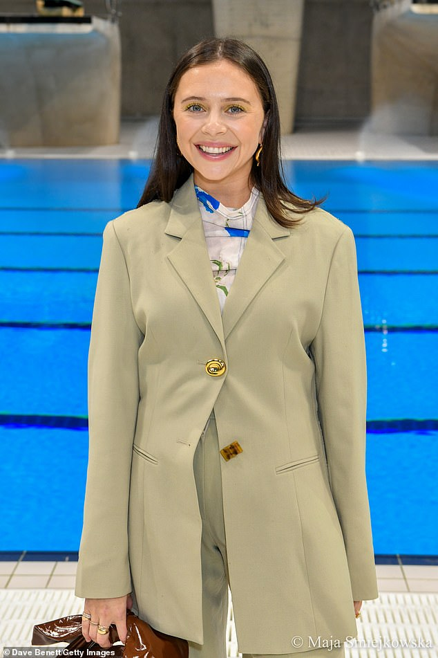 All smiles:The Morning Show's Bel Powley grinned for snaps in a conservative taupe trouser suit and a patterned blouse at the Rejina Pyo show for London Fashion Week on Sunday