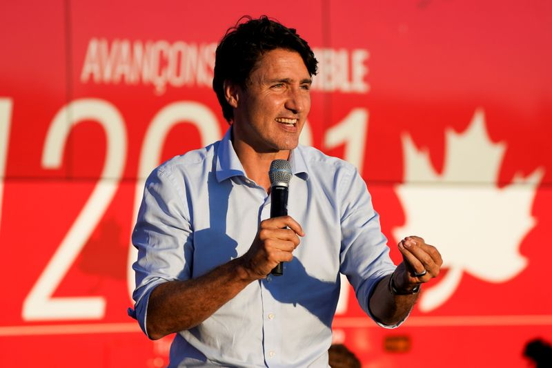 Trudeau warns against vote split in tight Canada election