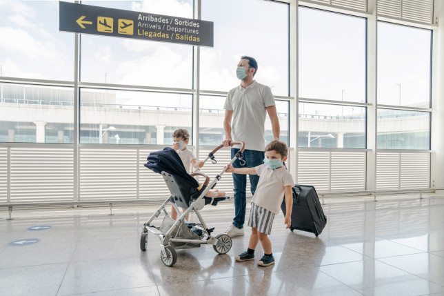 A man with children at the airport
