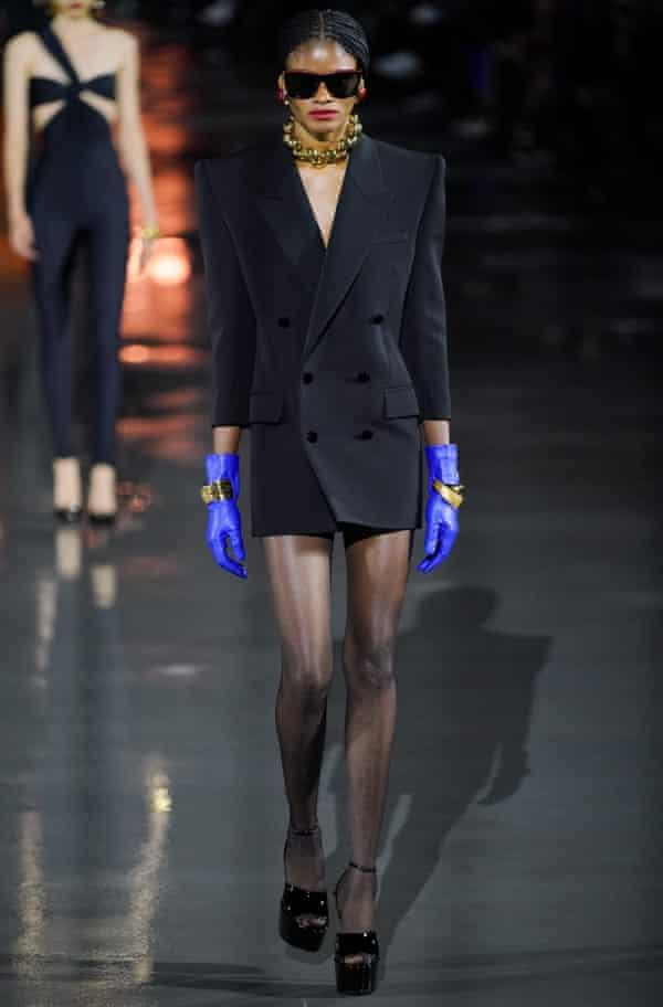A Saint Laurent model wearing a micro mini