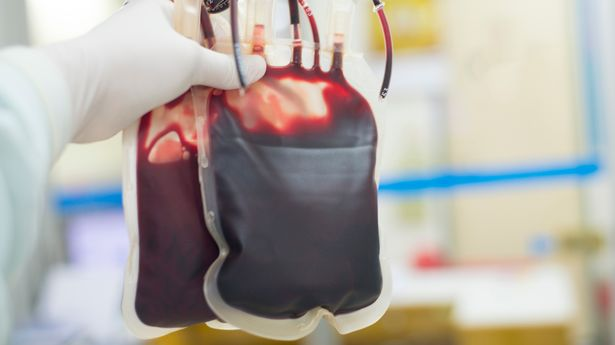 Red blood bag in hand