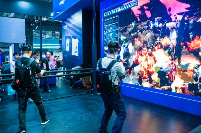 Gaming Ban in China - A foreign attendee at the 2019 China International Technology Expo tries VR gaming equipment developed by Tsinghua Tongfang
