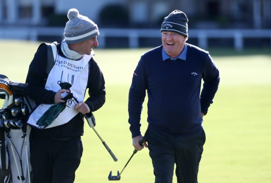 Piers Morgan smiles as he walks on the 1st hole during Day Two of The Alfred Dunhill Links Championship at The Old Course on October 01, 2021 in St Andrews, Scotland