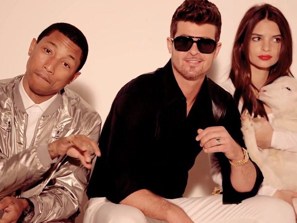 Pharrell Williams, Robin Thicke and EmilyRatajkowski in the music video for the controversial 2013 hit Blurred Lines