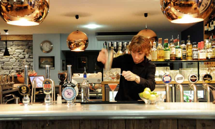 A bar tender behind the bar at The Harbourmaster pub in Aberaeron