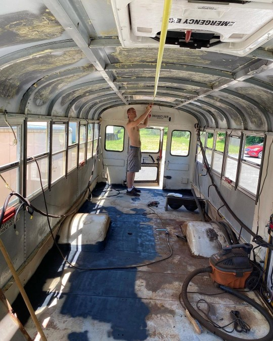 Spike Stone working on the bus.