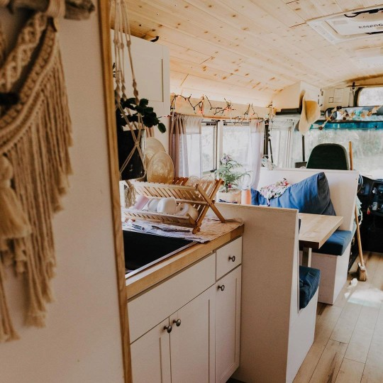kitchen and dining area in renovated school bus