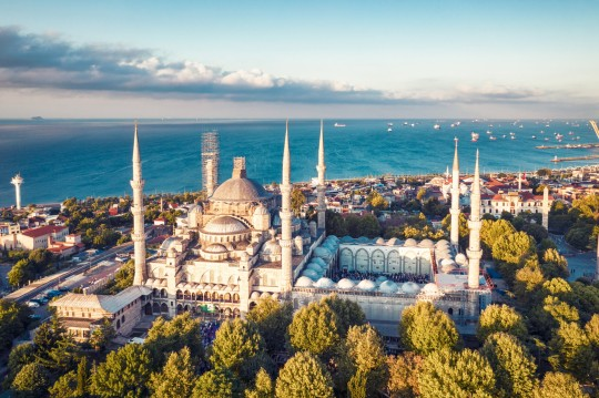 Sunrise drone photo of Sultan Ahmed Mosque and the Istanbul cityscape in the dawn. The Sultan Ahmed Mosque???The Blue Mosque) is a historic mosque located in Istanbul, Turkey. A popular tourist site. Photo taken on 08/11/2019 by drone device.