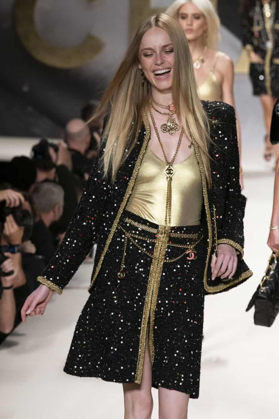 Models smiled and laughed as they walked down the catwalk.