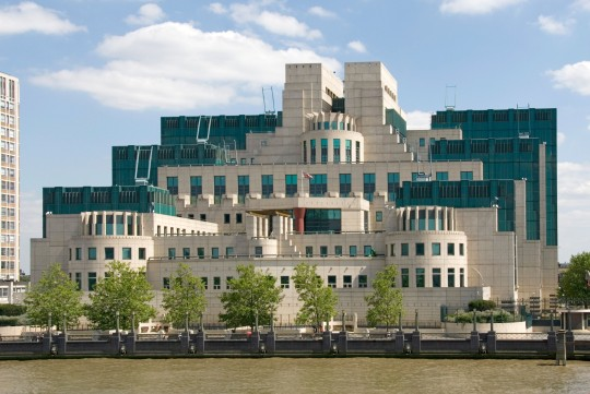 AFJCRE River Thames and the modern architecture of riverside Mi6 building at Vauxhall Cross HQ of the Secret Intelligence Service SIS London England UK