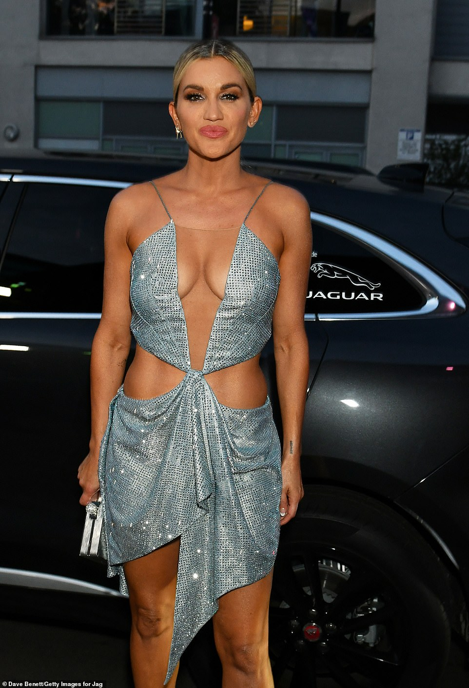 Beauty:She put on a busty display in the dress which she teamed with silver heels and a matching clutch bag
