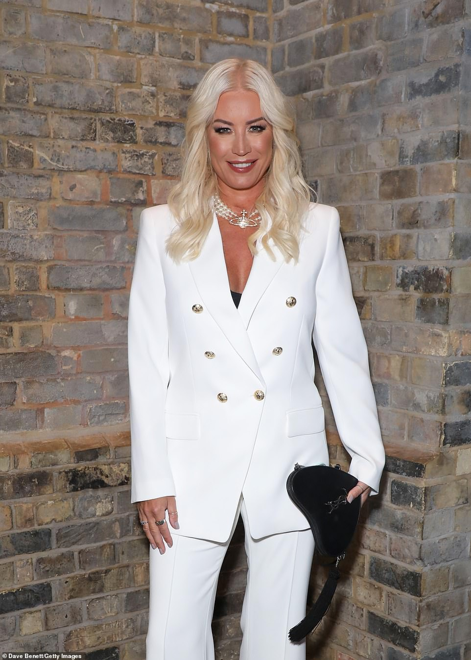 Glowing: Denise wore her blonde tresses in loose waves and opting for a glamorous makeup look