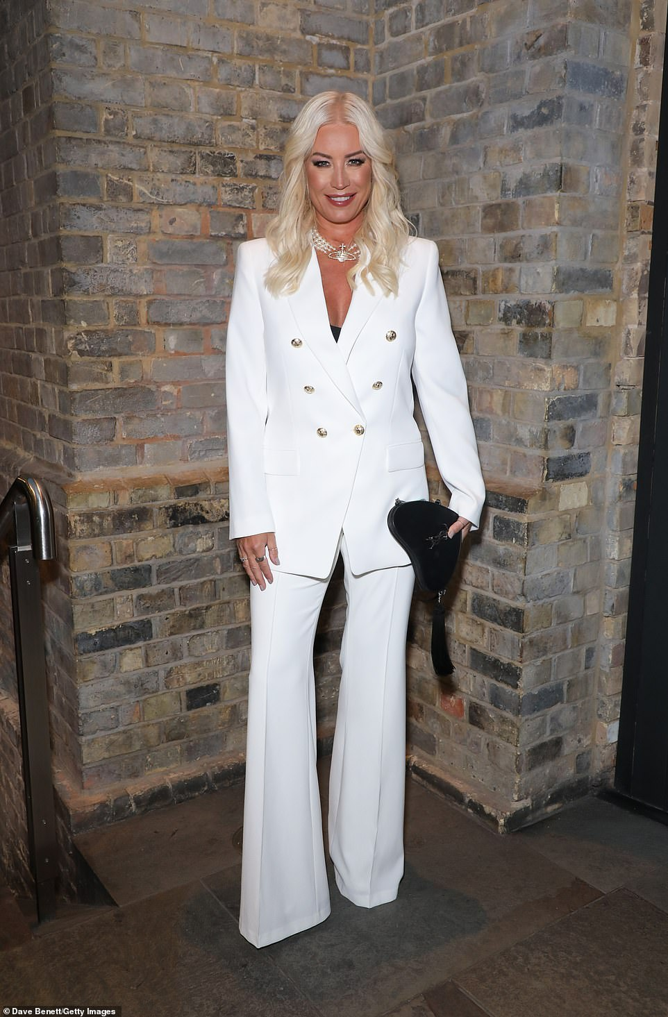 Star: Denise made sure all eyes were on her in the chic white suit