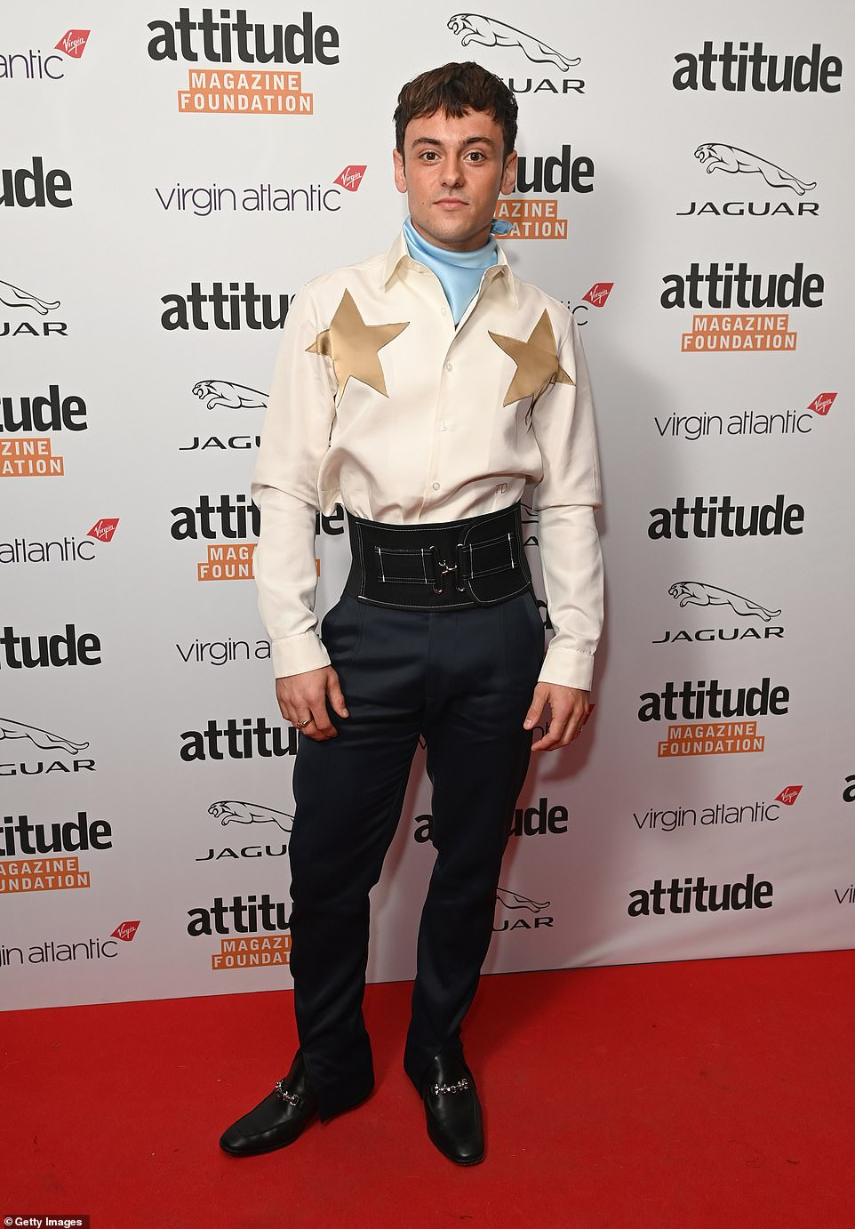 Busy week:Tom Daley looked handsome in a star-design shirt after attending Paris Fashion Week earlier this week