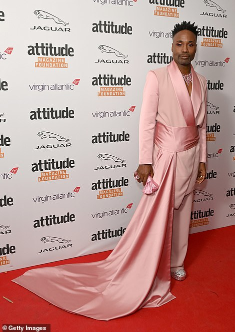 Iconic look: Billy Porter looked incredible in a pink flowing suit as he wowed on the red carpet