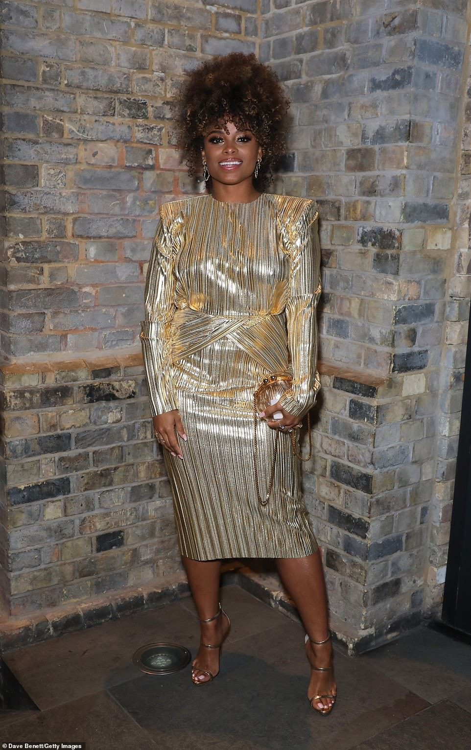Golden girl: Singer Fleur East wowed in a gold midi dress as she attended the event