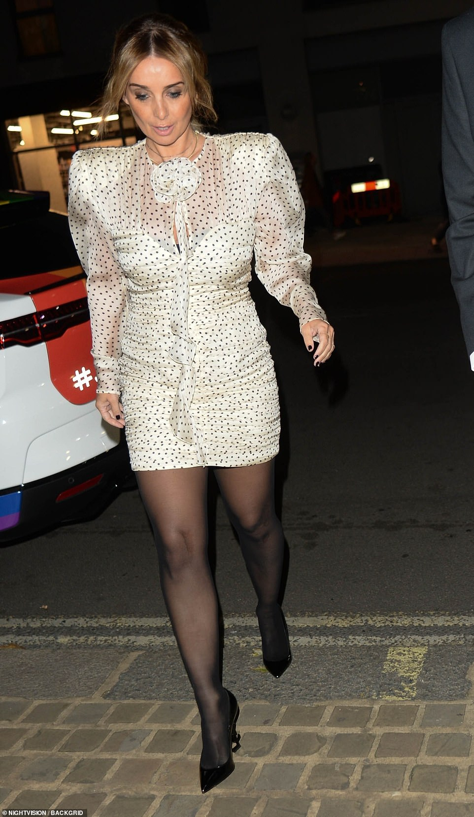 Figure: LouiseRedknapp showed off her legs in a white dress and black tights