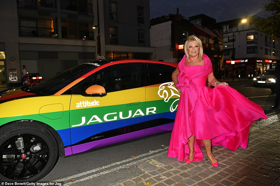 Pink to make the boys wink: ElainePaige looked great in a bright dress as she made her arrival