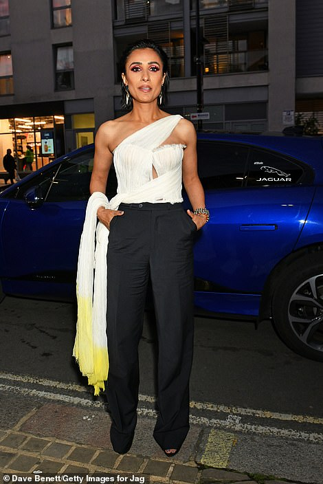 Sophisticated:Anita Rani wowed in an off-the-shoulder white top and high-waisted trousers