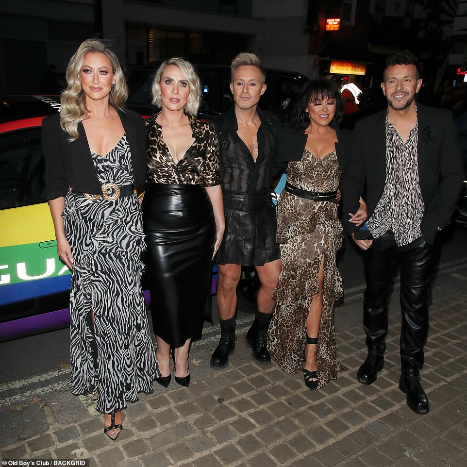 Out and about together: The Steps singers looked great as they posed together as a fivesome