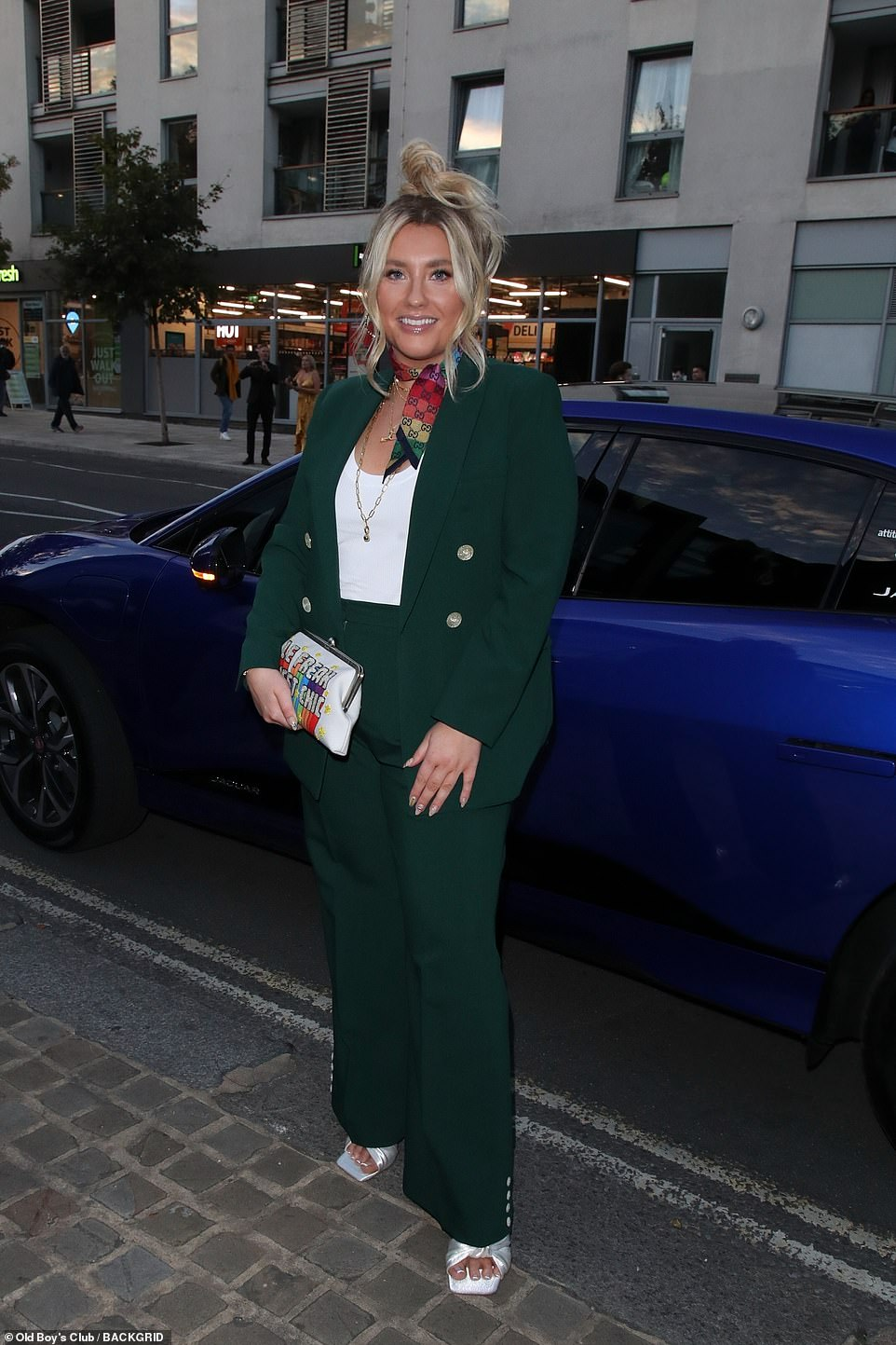 Smart look: X Factor singerElla Henderson wowed in a dark green suit for the event on Wednesday