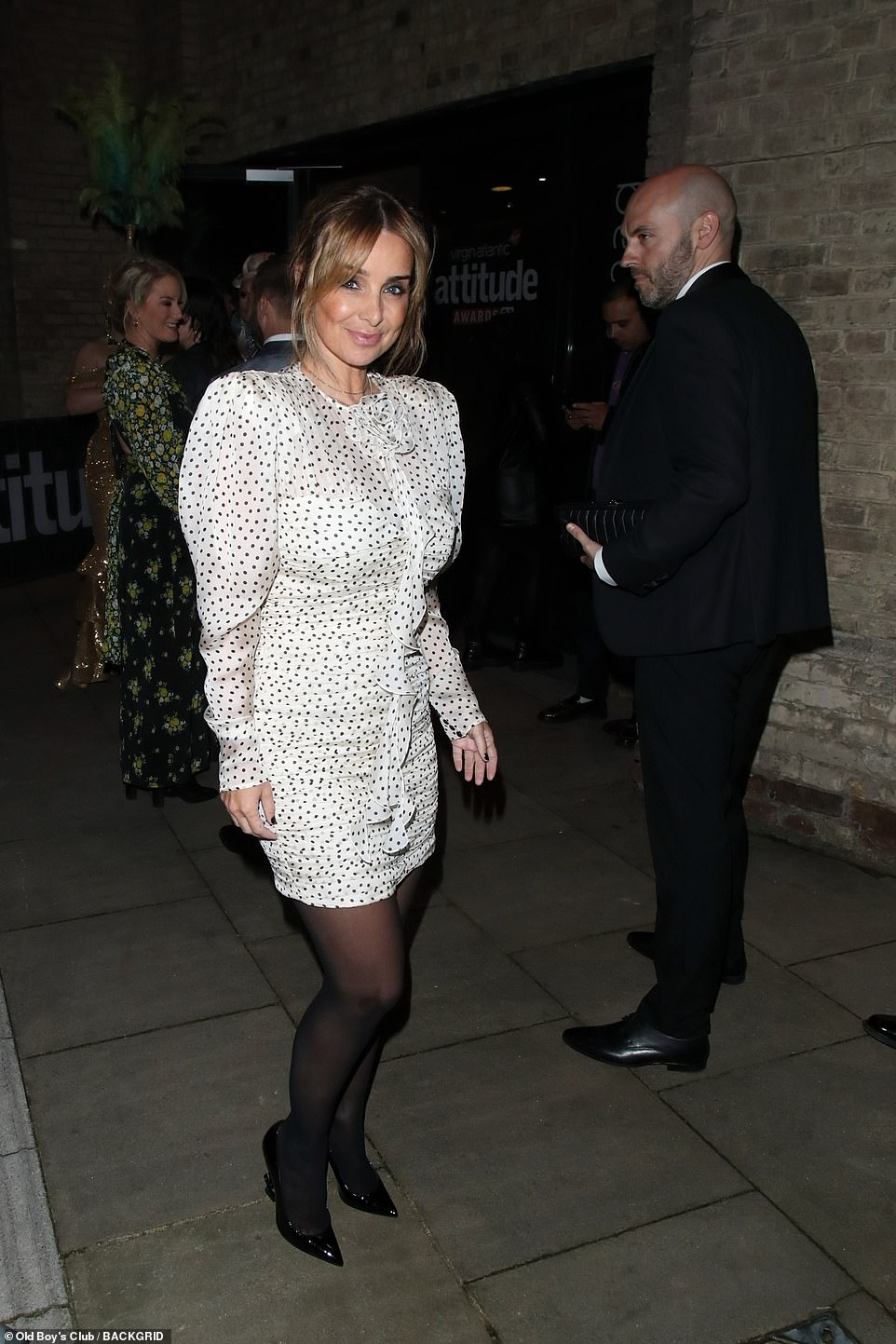 Glowing:Louise beamed as she headed into the venue in her polka dot dress