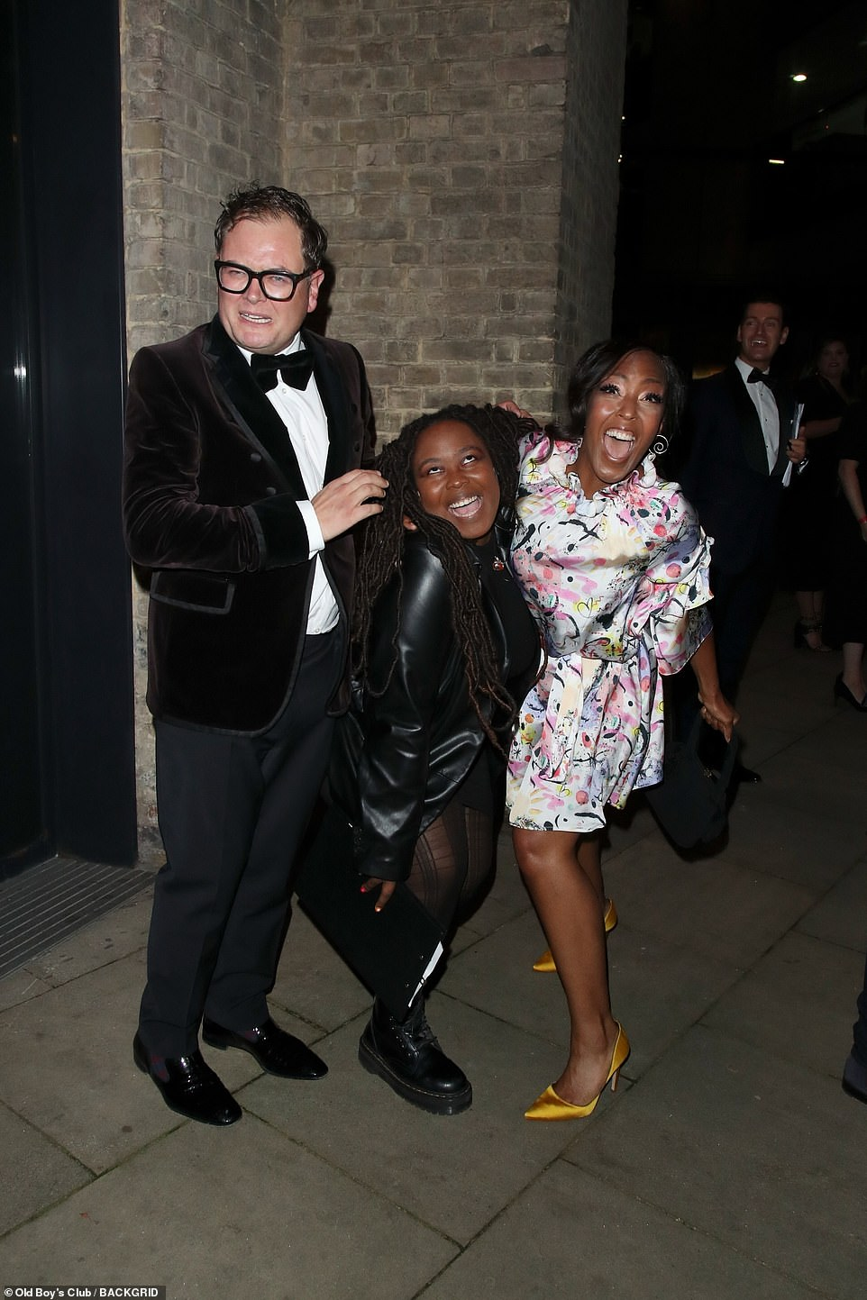 Party time: Alan looked great the event as he posed with pictures with Angelica Bell