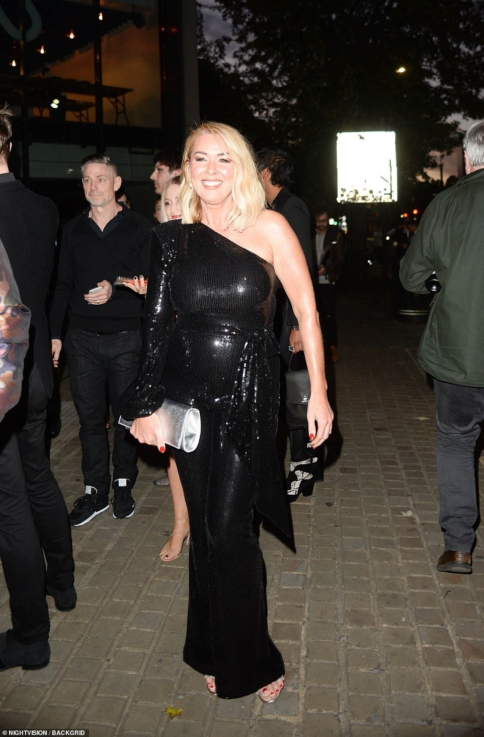 Glamorous:Claire Sweeney wowed in a glitzy black jumpsuit